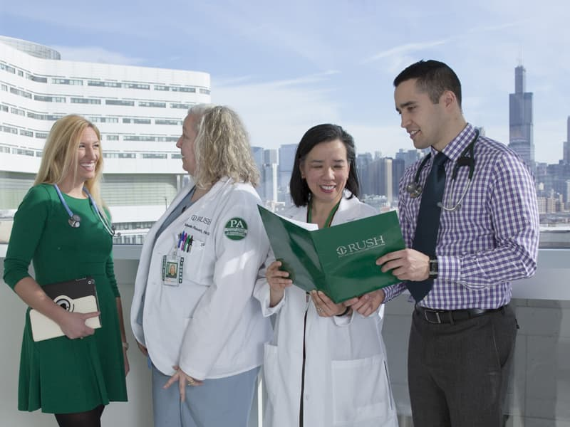 Rush physician assistant students and faculty conversing
