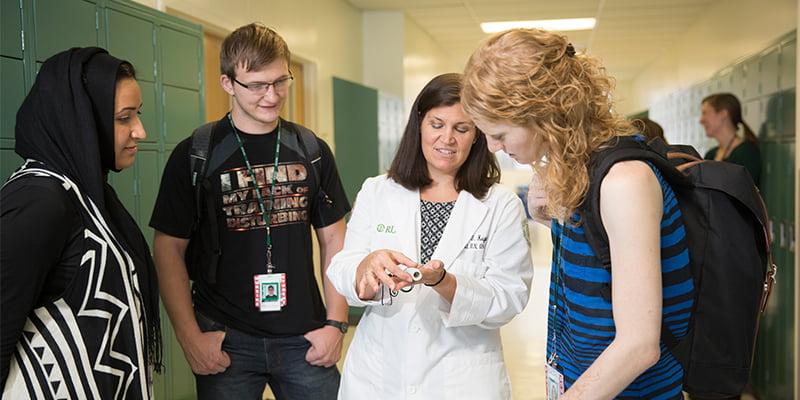 College of Nursing faculty member teaching students