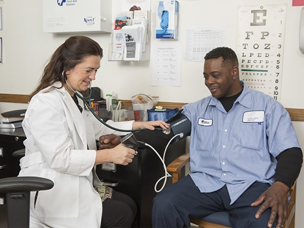 A Rush Faculty Practice nurse takes a patient's blood pressure