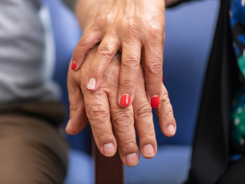 Close-up of two older adults' hands