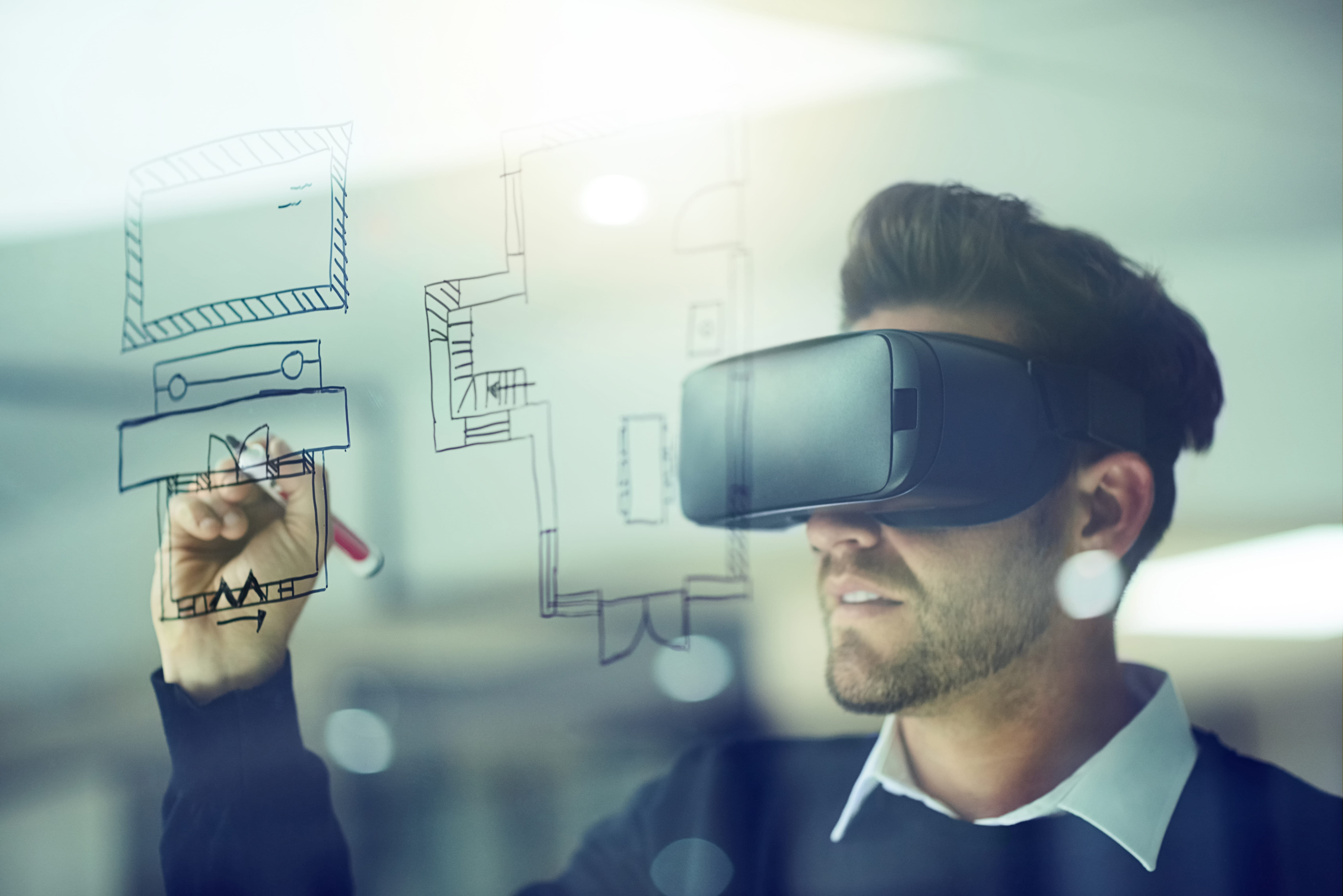 A student wearing virtual reality glasses performing a task