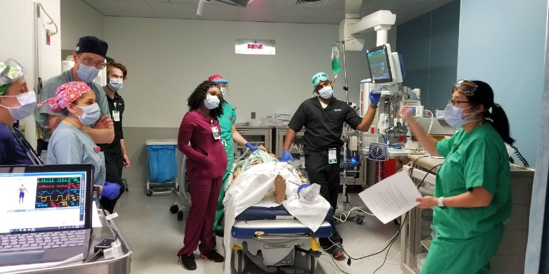 Instructor leading class in an emergency simulation lab