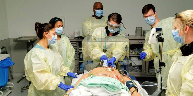 Group of doctors working on a manikin