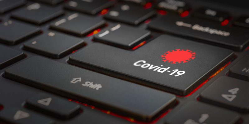 Computer keyboard with key labeled Covid-19