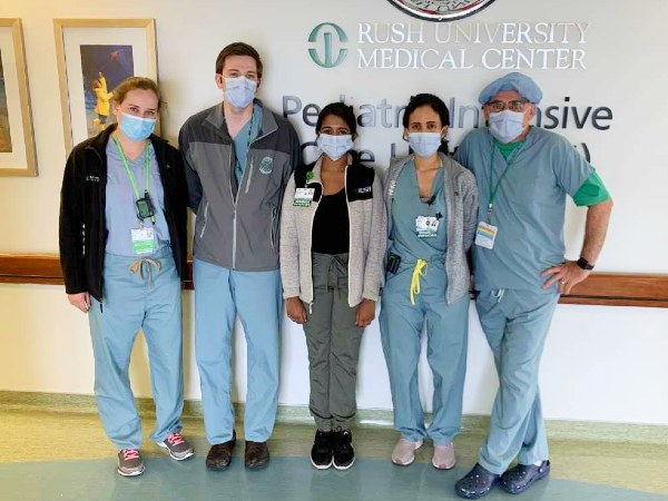 A group of health care providers wearing scrubs and masks at the Rush Pediatric Intensive Care Unit