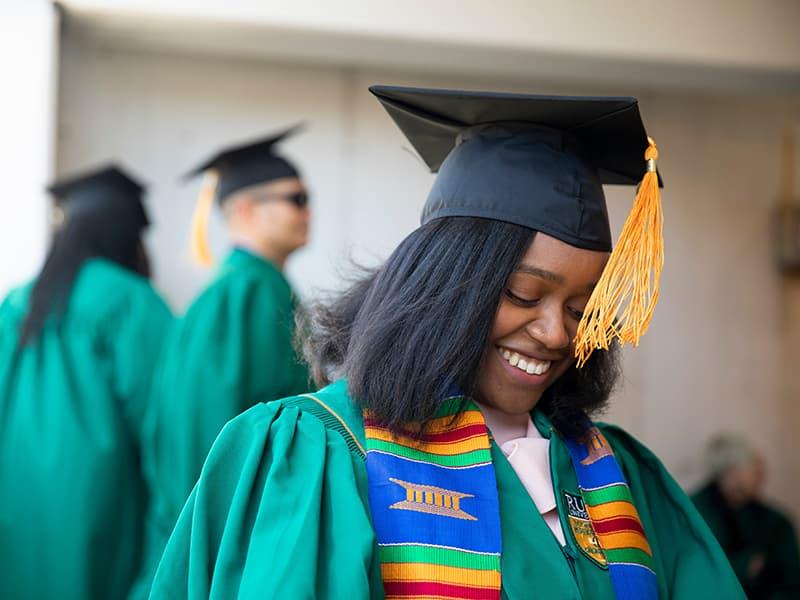 Rush student at graduation
