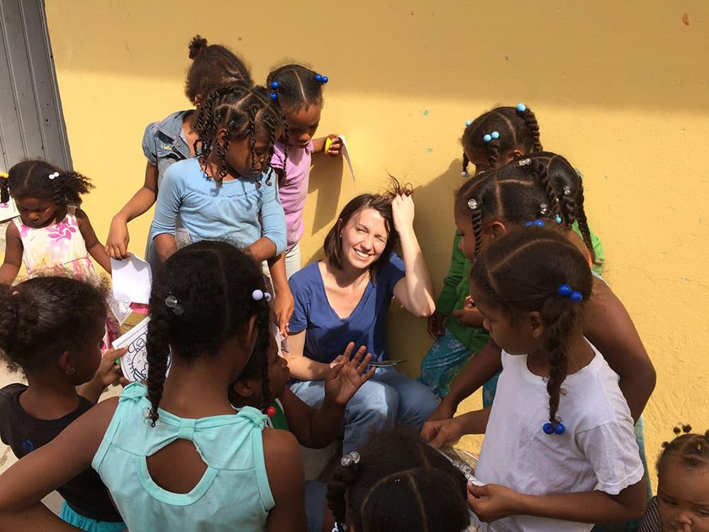 Student helping children