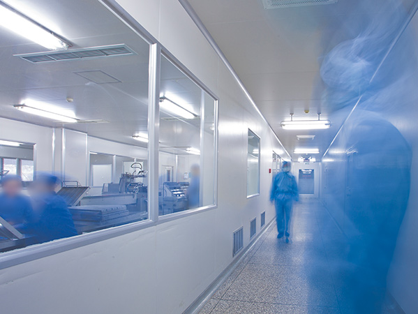 Hospital corridor with staff in protective wear
