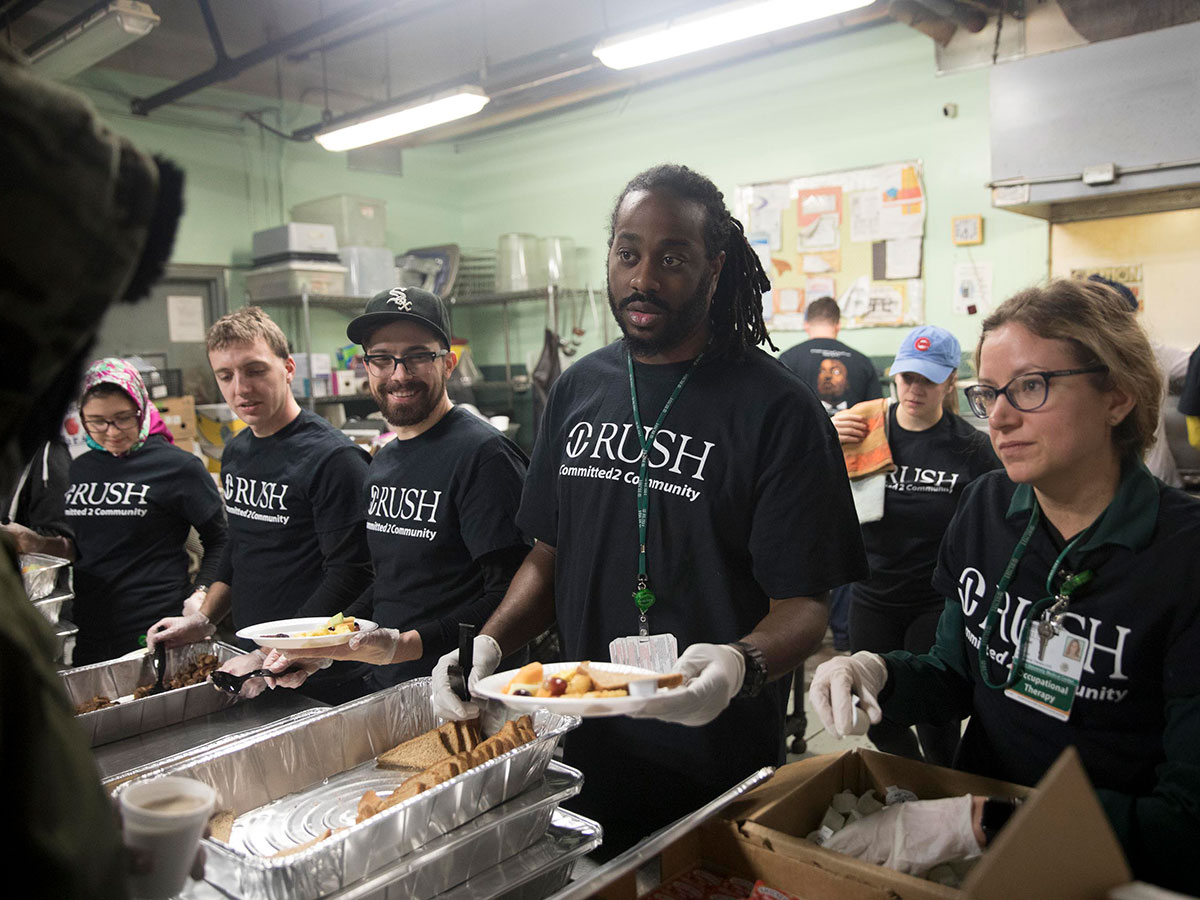 Students serve food at Franciscan House