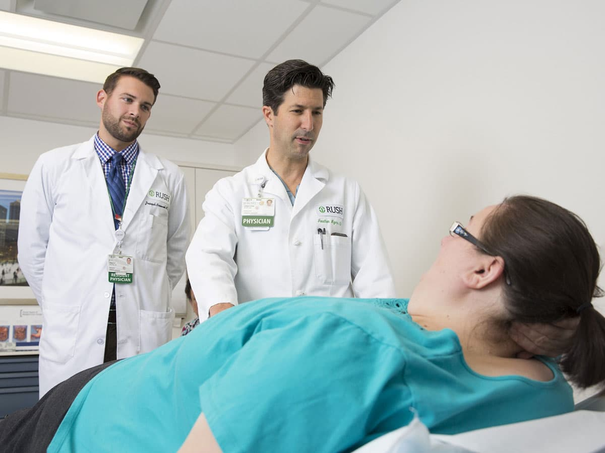 Doctor and resident with a patient