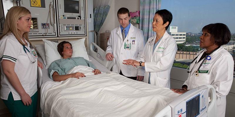 Doctors with a patient