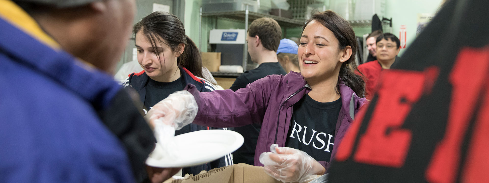 Rush University student volunteering at Franciscan House
