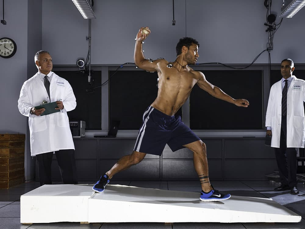 Scientists and subject in gait lab