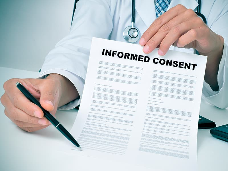 Researcher show informed consent form