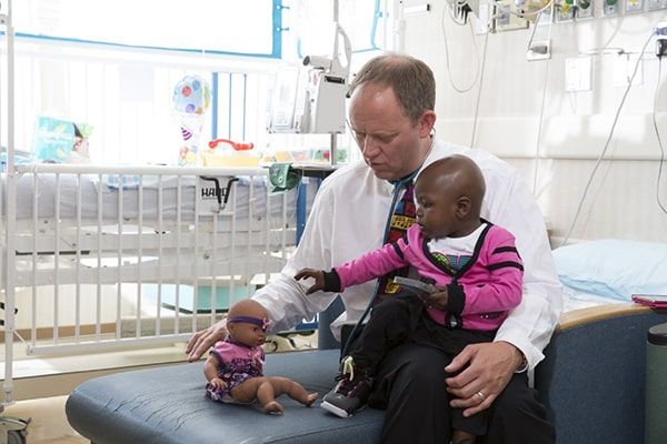 Rush University Children's Hospital physician treating pediatric patient
