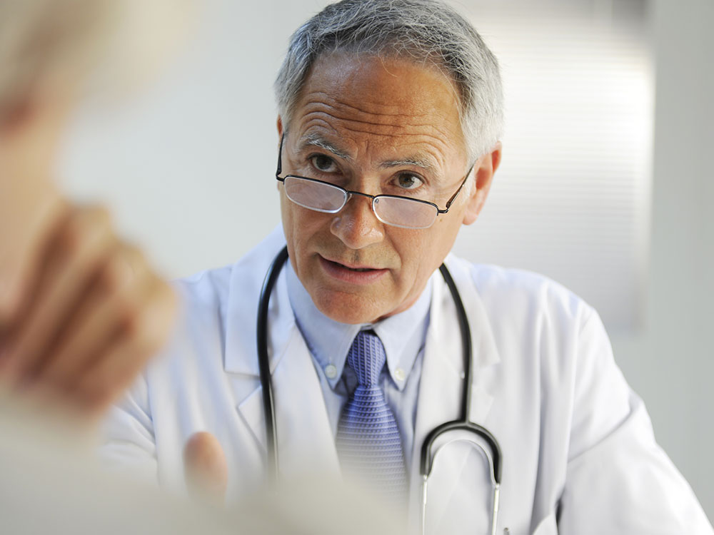 Doctor practicing Screening Brief Intervention & Referral to Treatment