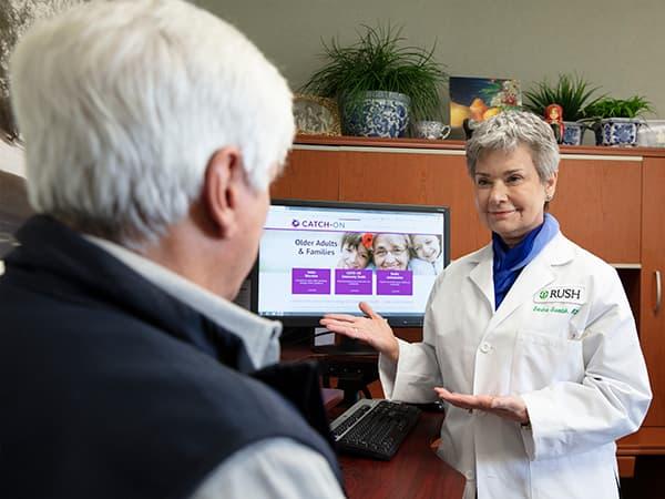 Doctor educating older adult