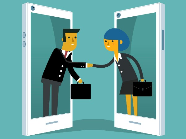 Illustrated figures reaching out from smartphones to shake hands