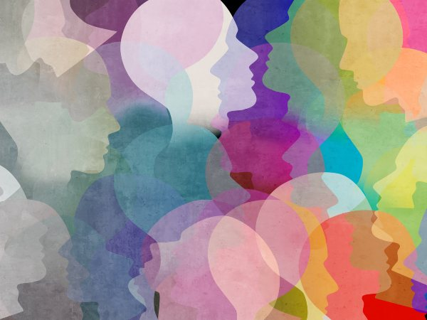 Superimposed silhouettes of faces in rainbow colors