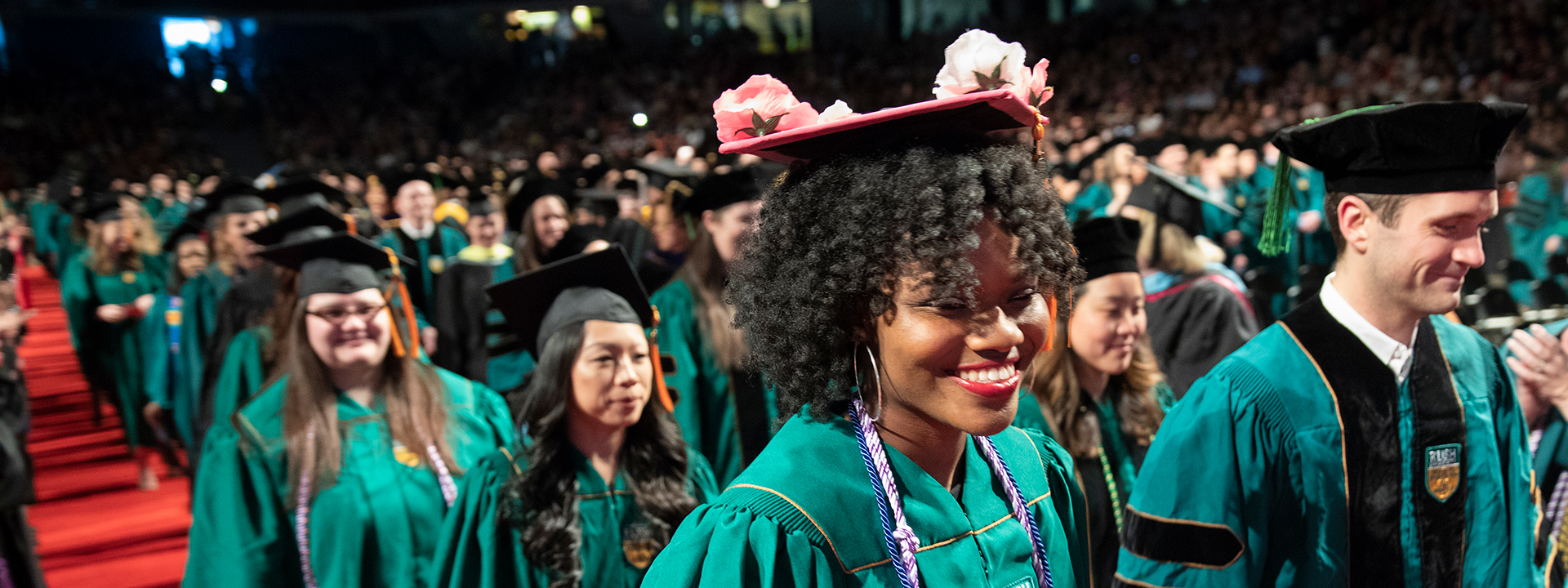 Rush students walking down the aisle at commencement