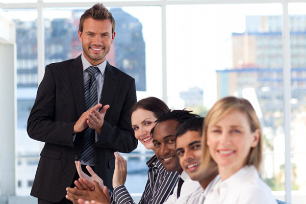 People applauding at a business meeting