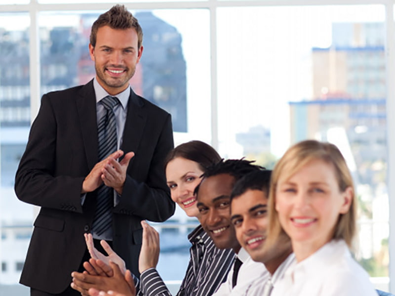 Employees applauding at a meeting