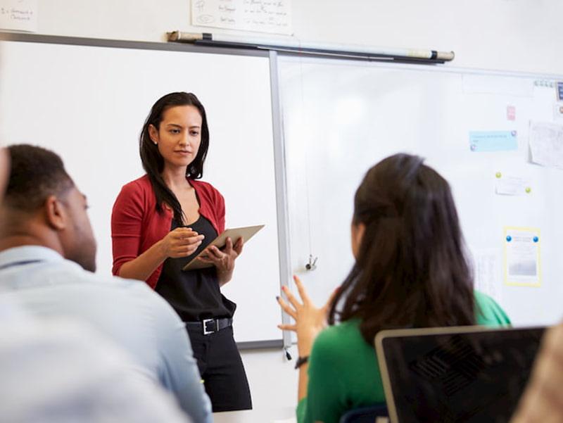 A teacher instructing a class