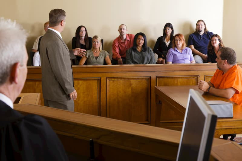 A lawyer addressing a jury
