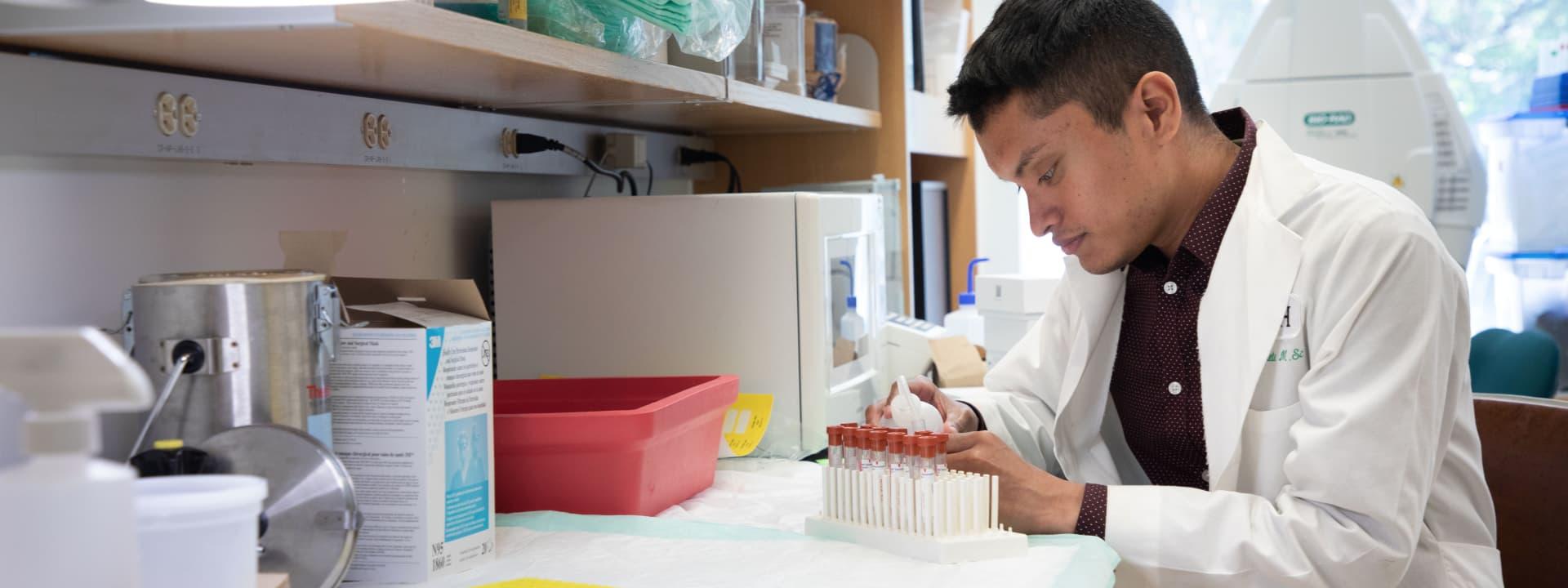 A Rush researcher in a lab.