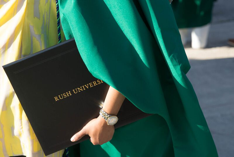 Student holding diploma cover