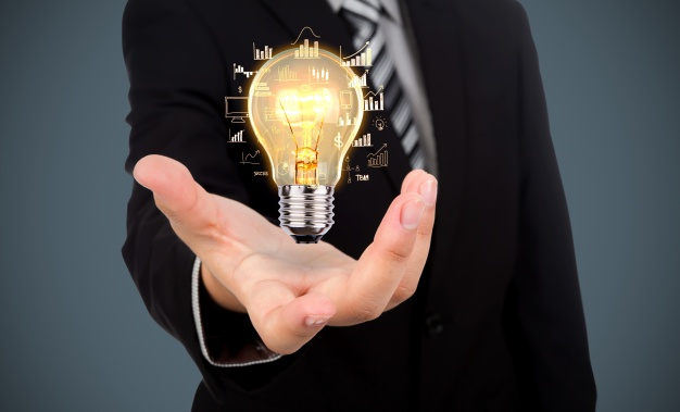 Person with an outstretched hand with an image of a shining lightbulb over the hand