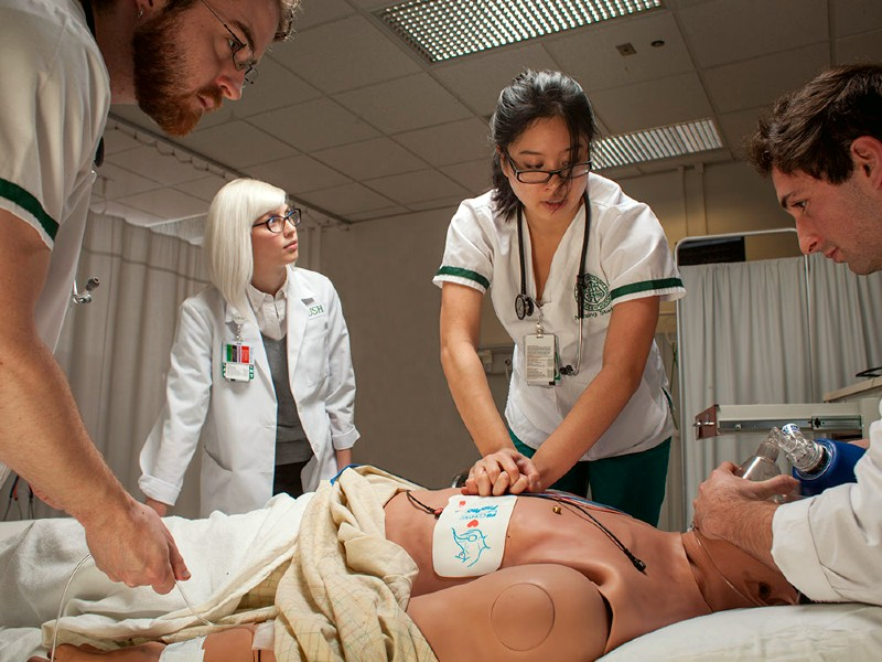 Nursing students practice resuscitation on a dummy