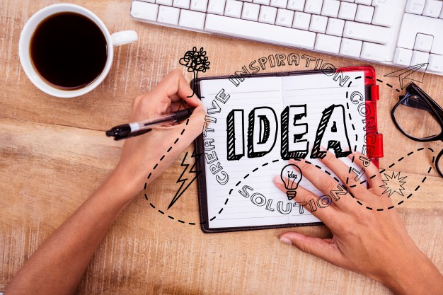 Female by a computer with the word Idea